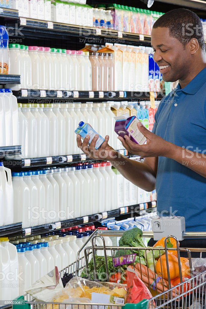 man choosing cartons stock photo