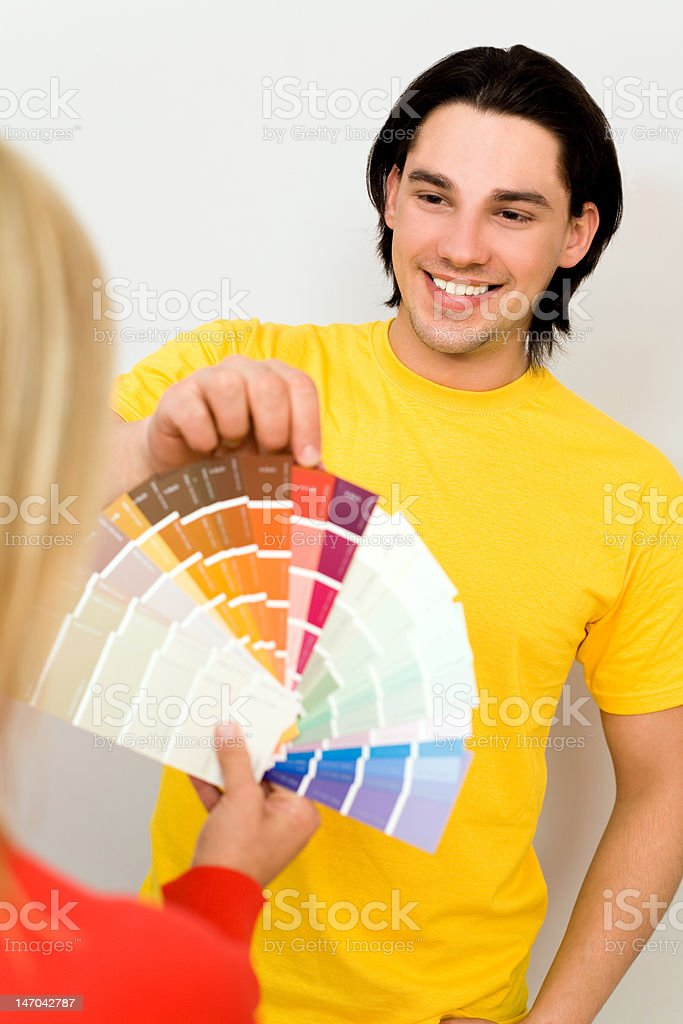 Man choosing colour swatches royalty-free stock photo
