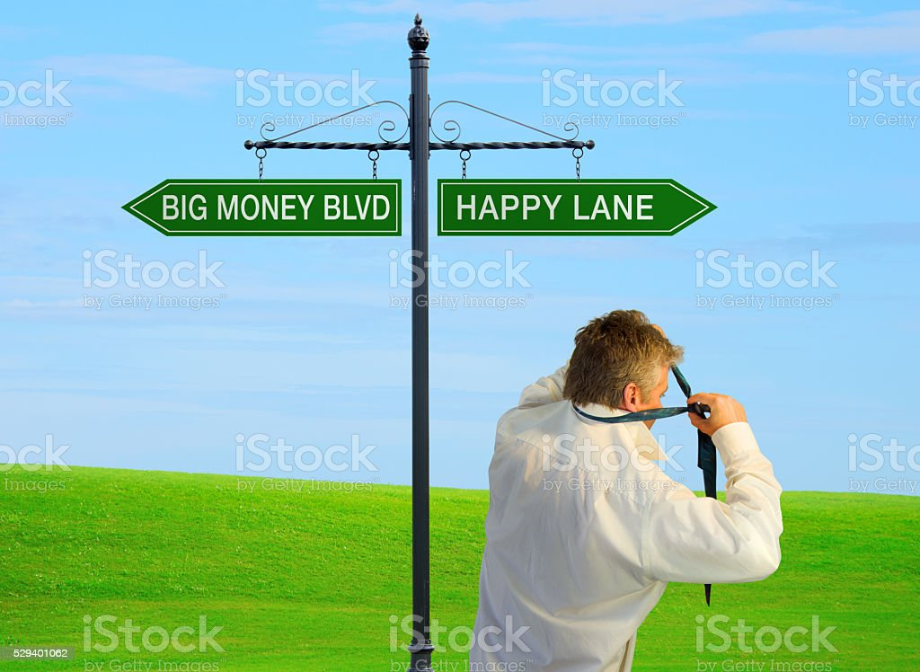 Man choosing happiness over wealth stock photo