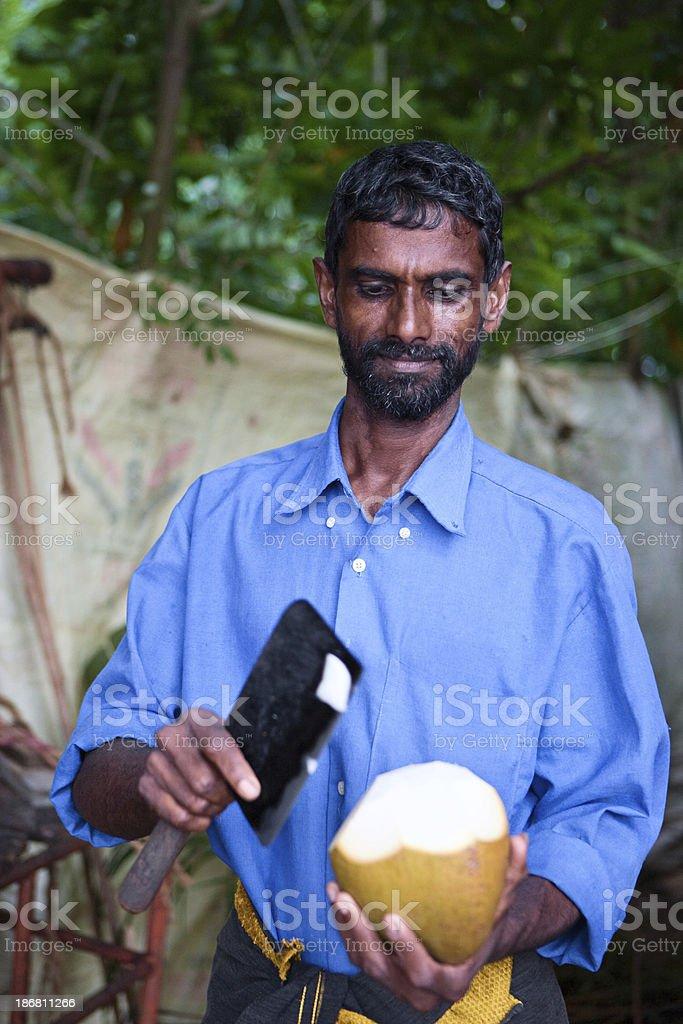 Man chopping coconut royalty-free stock photo