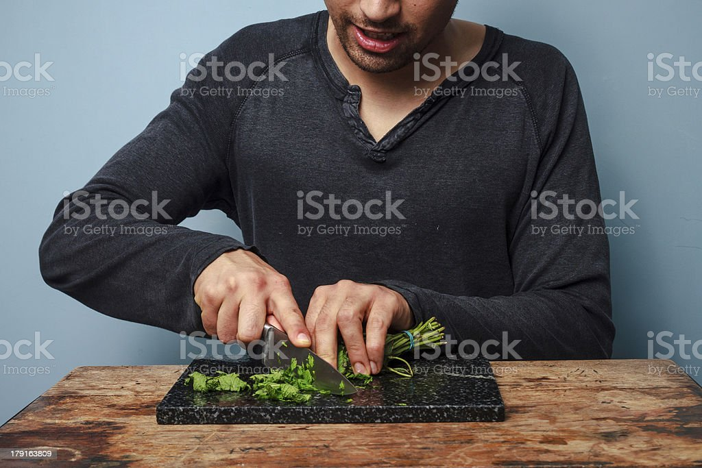 Man chopping herbs royalty-free stock photo