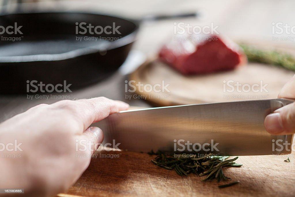 Man chops herbs stock photo