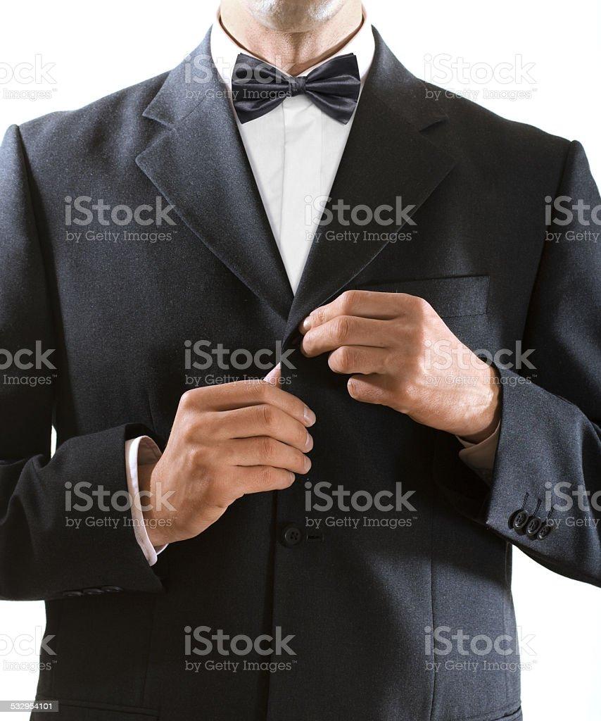 man clasps a jacket button stock photo