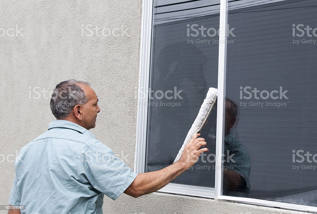 Man Cleaning A Window - Janitorial Services Series royalty-free stock photo