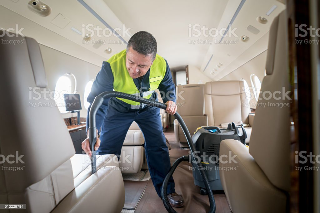 Man cleaning an airplane stock photo
