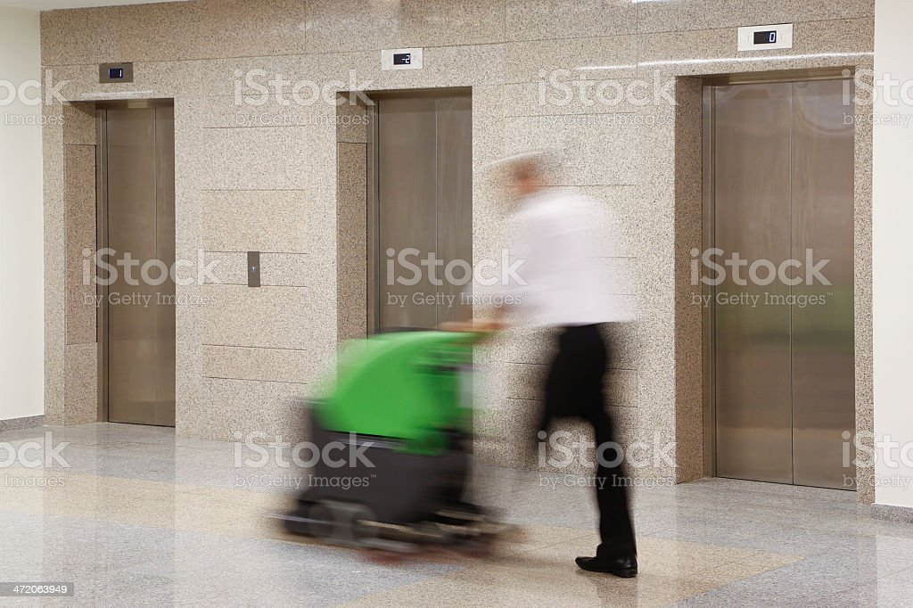 Man Cleaning an Office stock photo