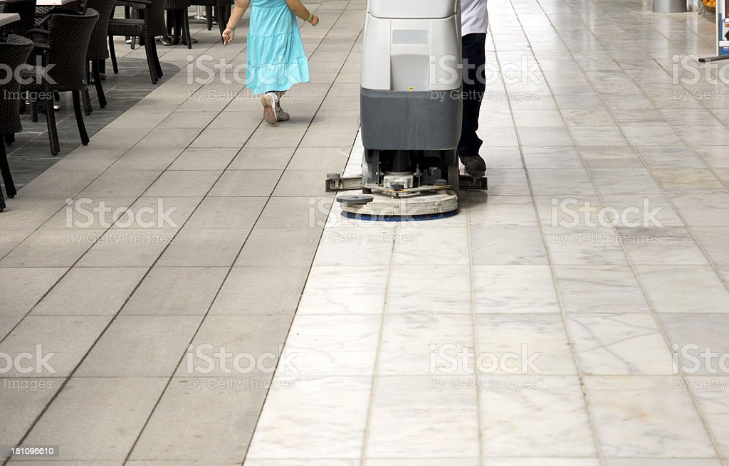 Man Cleaning Cafe Floor stock photo