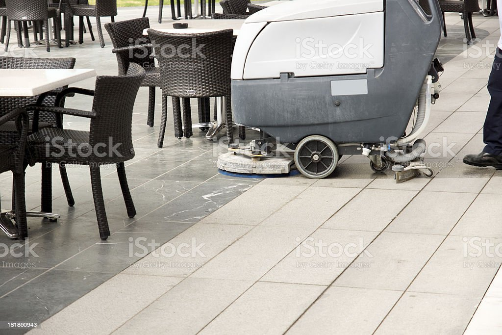 Man Cleaning Cafe Floor royalty-free stock photo