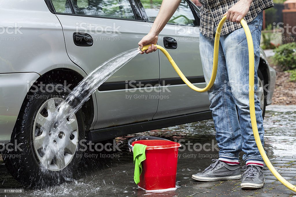 Man cleaning car stock photo