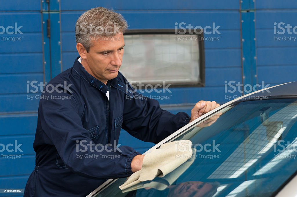 Man Cleaning Car With A Cloth stock photo
