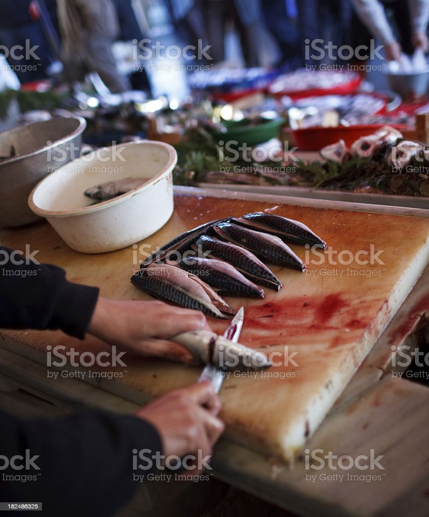 Man cleaning fish in fishmarket royalty-free stock photo