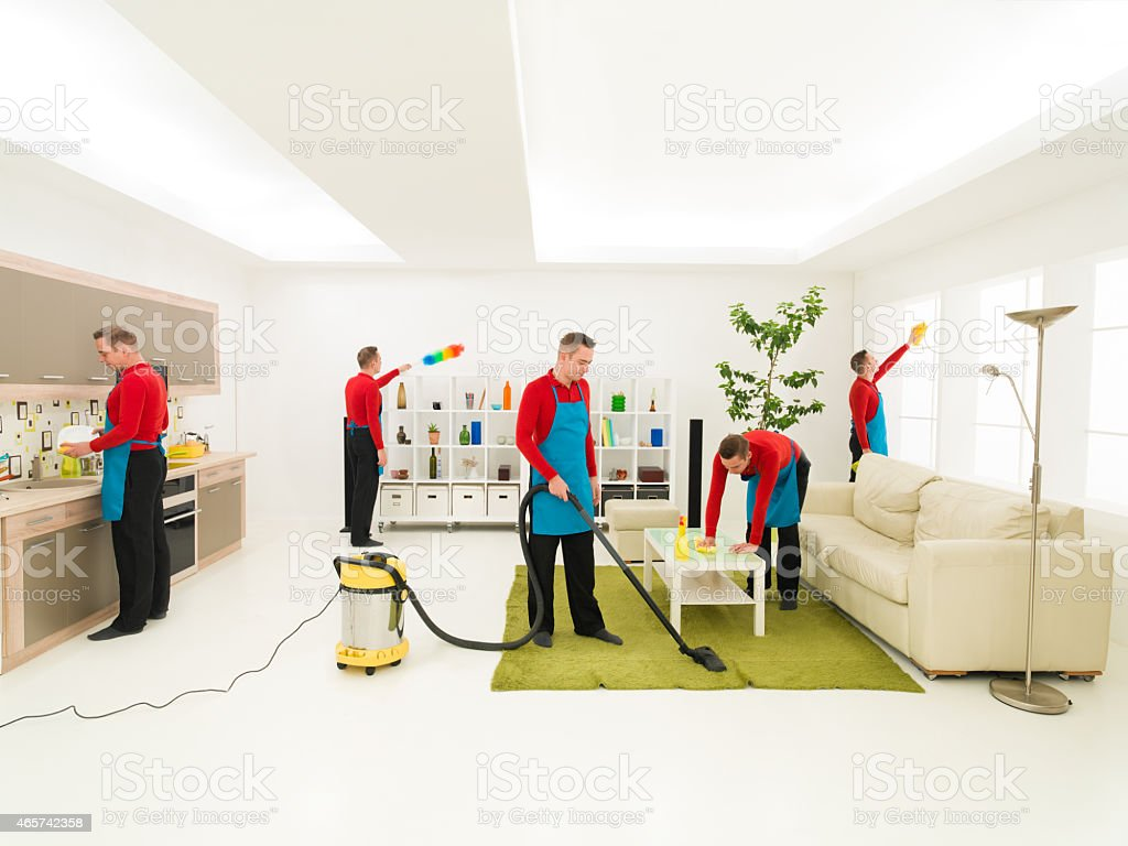 man cleaning home stock photo