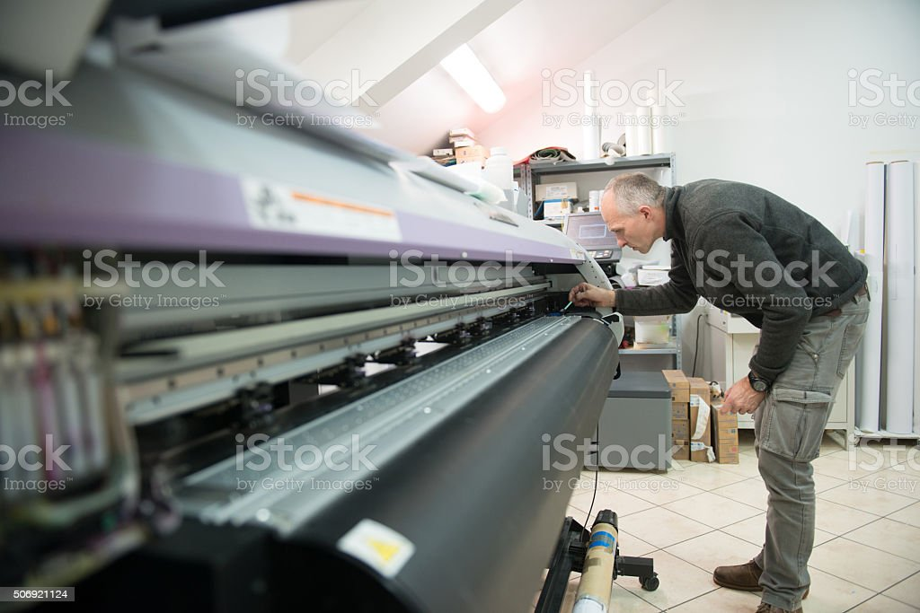 Man Cleaning Large Format Printer Head stock photo