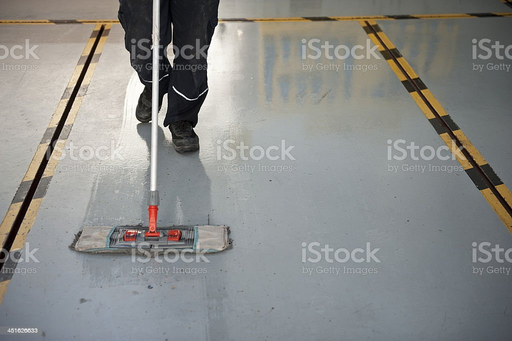 Man cleaning the floor royalty-free stock photo