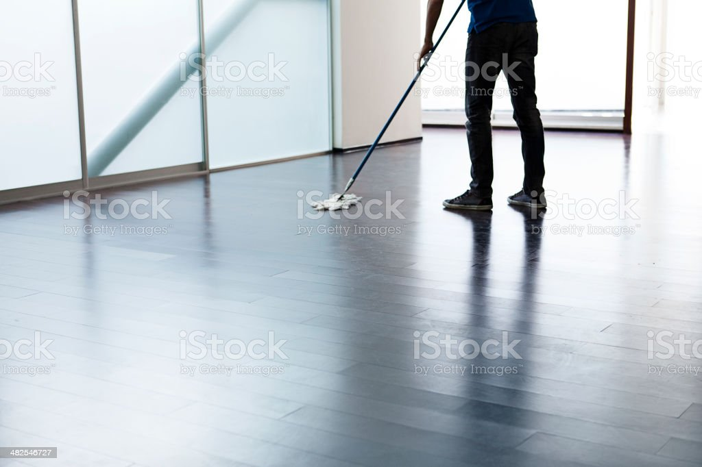 Man cleaning the floor stock photo