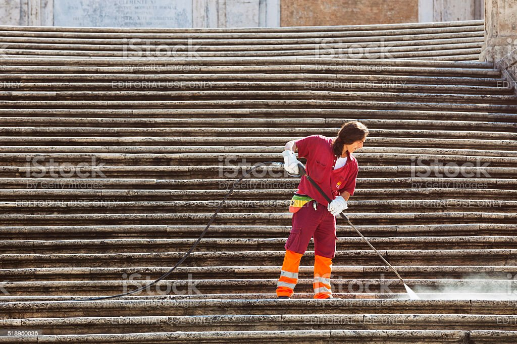 Man cleaning the Spanish Steps in Rome, Italy stock photo