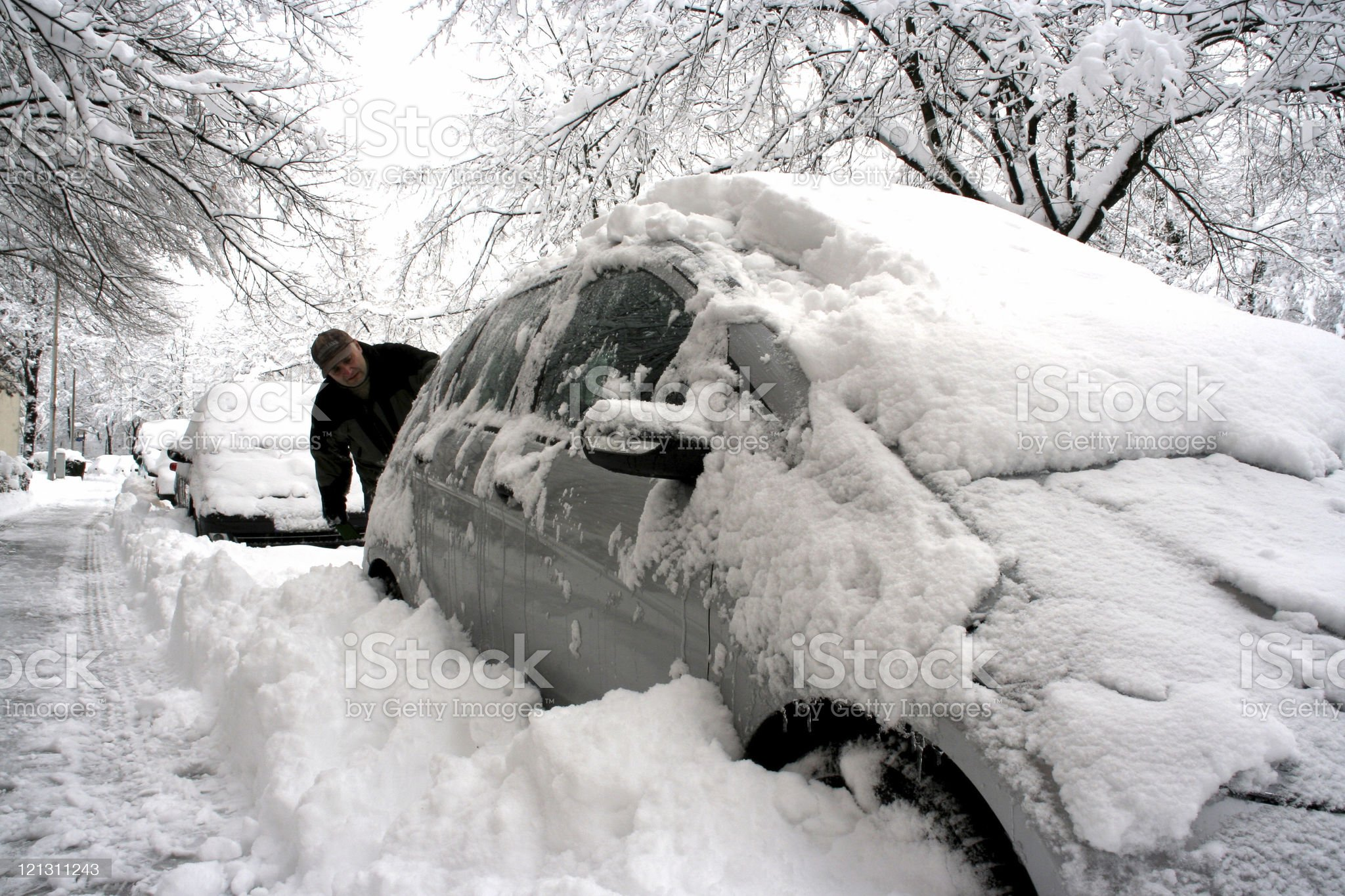 Man clearing off car after big snowfall royalty-free stock photo