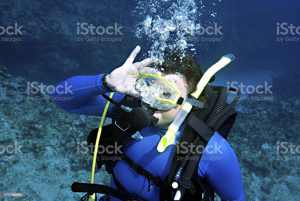man clearing scuba mask stock photo