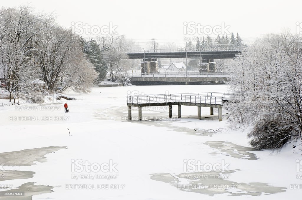 Man Clearing Skating Rink on the Speed River stock photo
