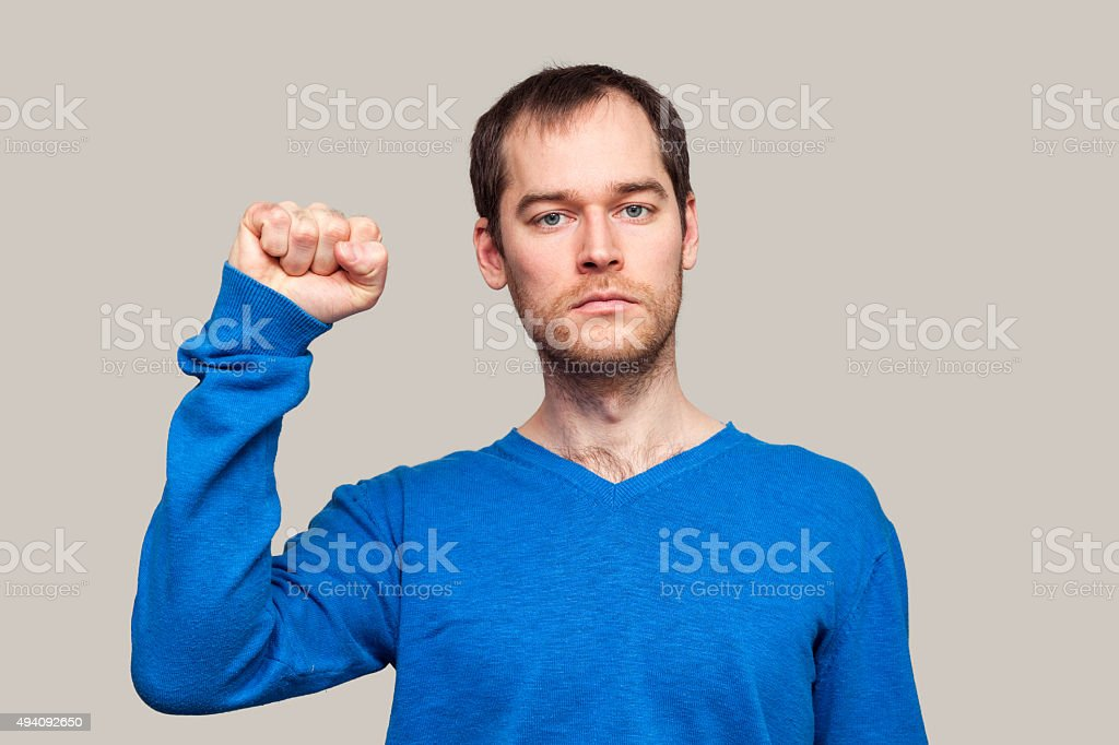 Man clenching fist stock photo