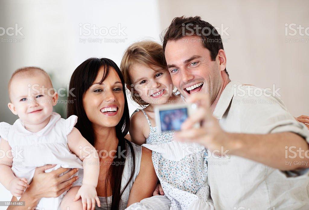 Man clicking family's photos royalty-free stock photo