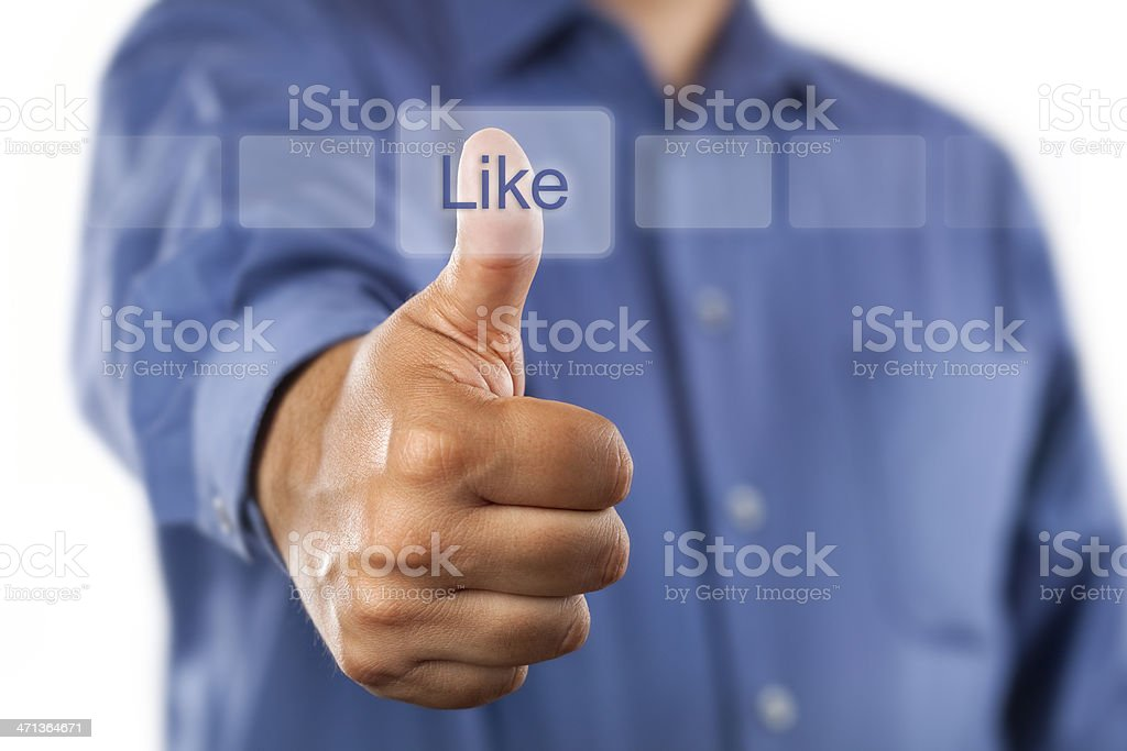 Man clicking like button with thumbs up royalty-free stock photo