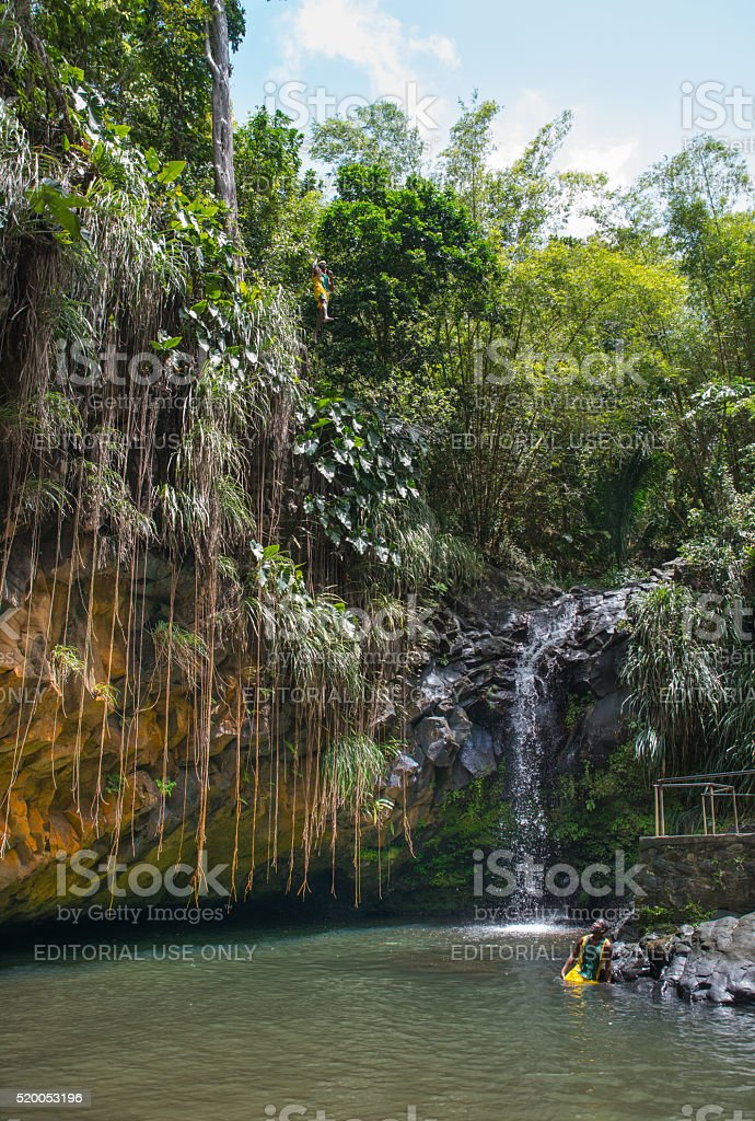 Man cliff jumping on a pool of Annandale waterfall royalty-free stock photo