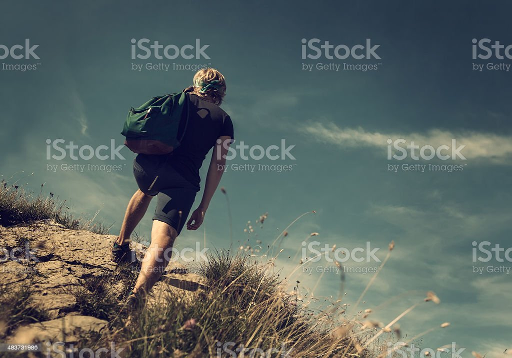 Man climb on mountain hill stock photo