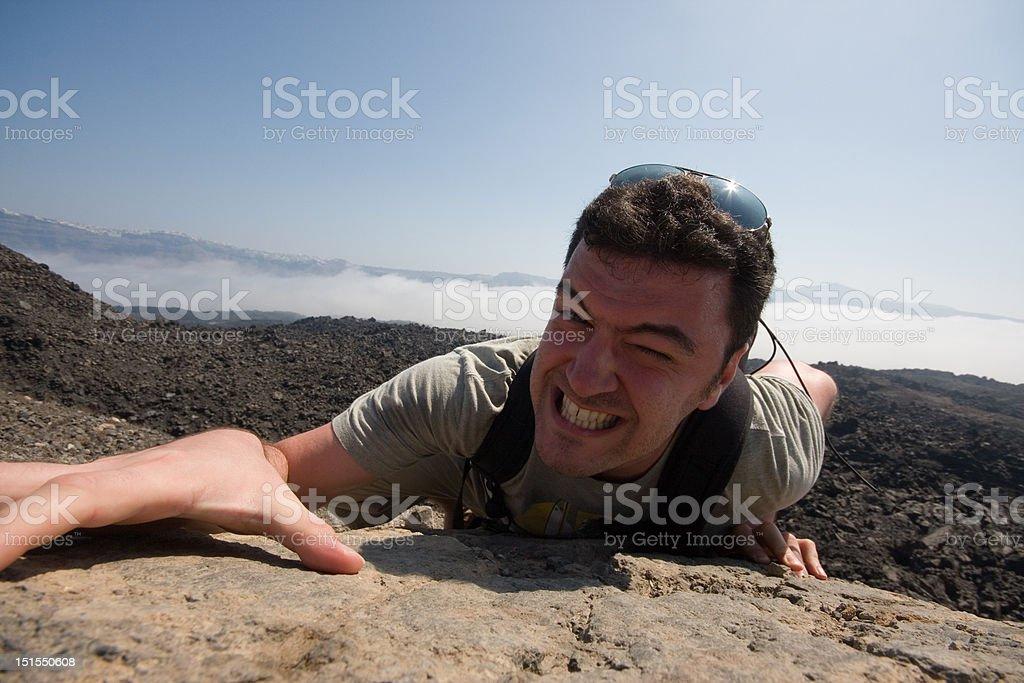 Man climbing a mountain royalty-free stock photo