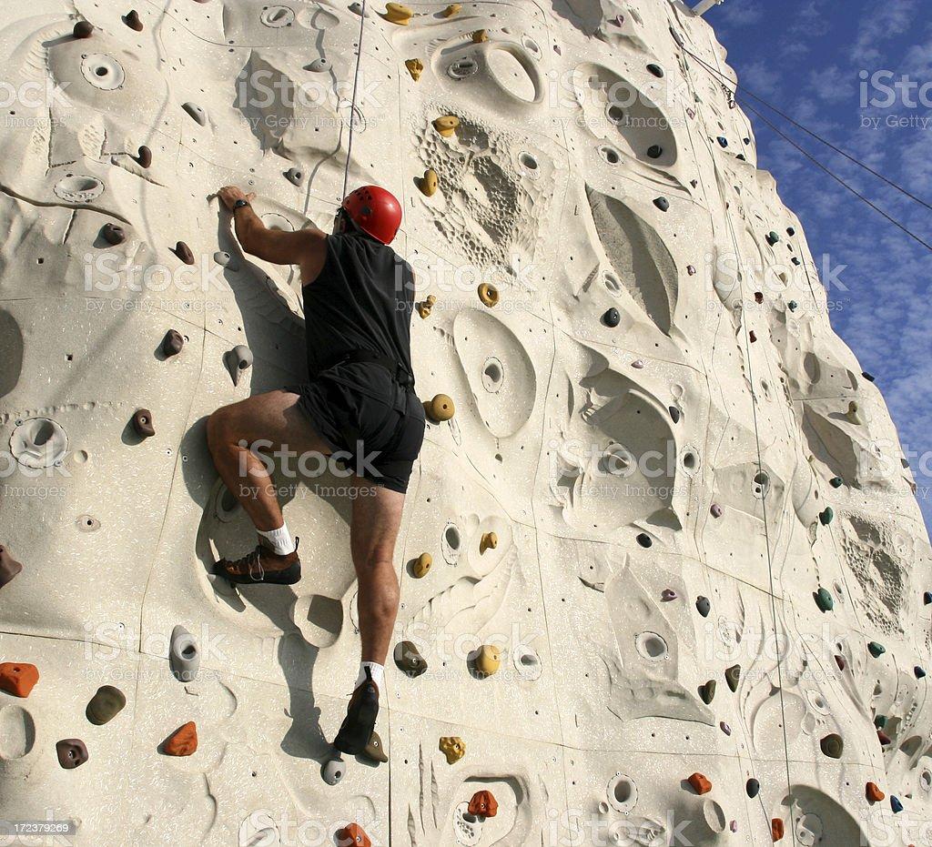 Man Climbing a Rock Wall stock photo