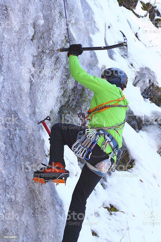 man climbing an ice wall royalty-free stock photo