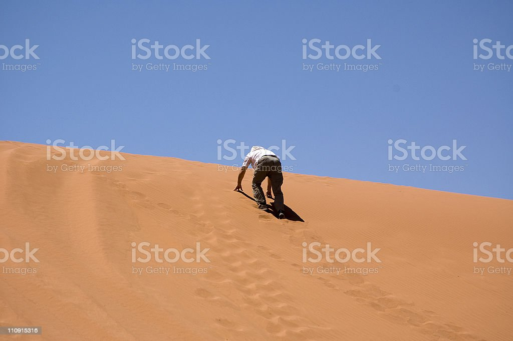 Man climbing Dune royalty-free stock photo