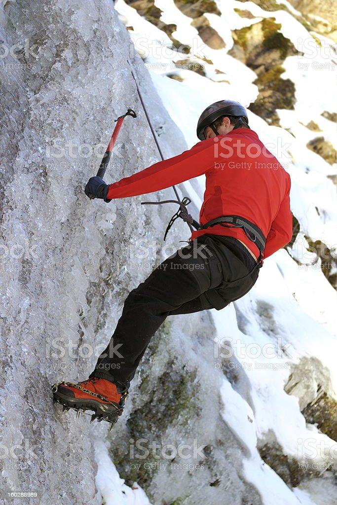 man climbing on ice royalty-free stock photo