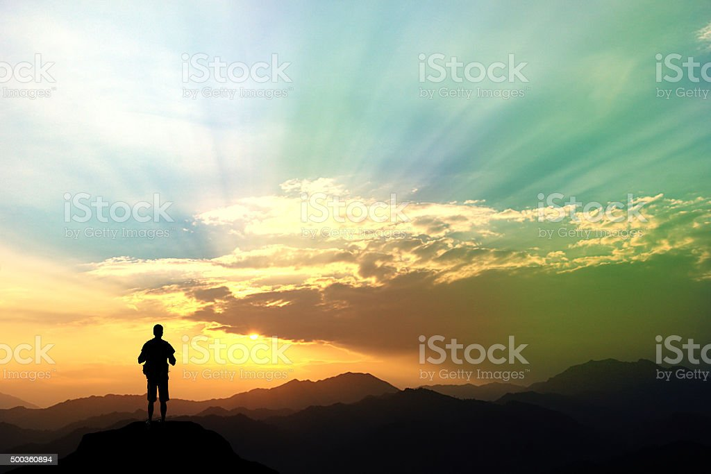 man climbing on mountain. stock photo