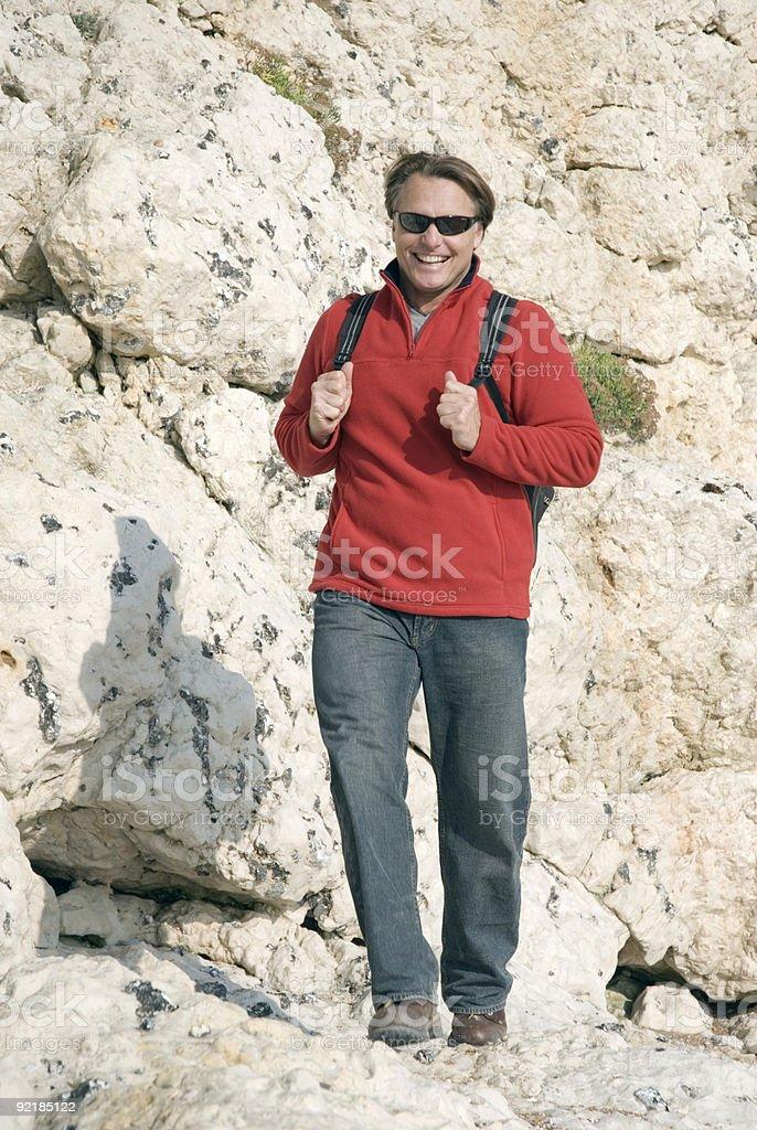 Man climbing rocks. royalty-free stock photo