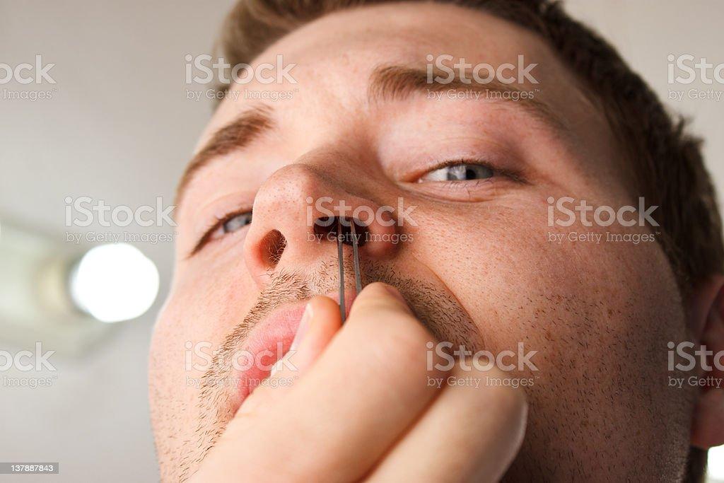 Man Close Nose Hair Pluck royalty-free stock photo