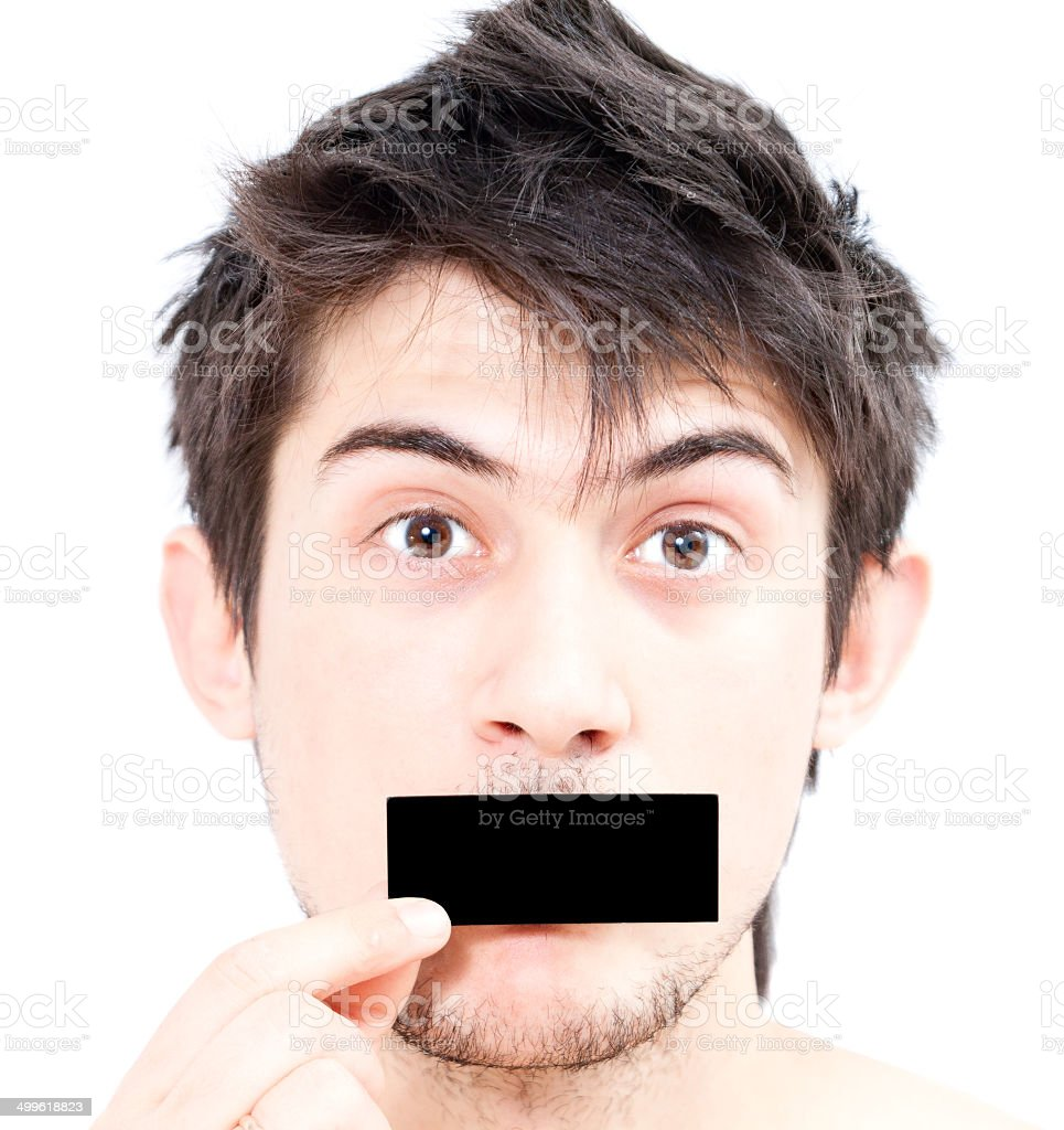 Man closed his mouth a piece of paper stock photo