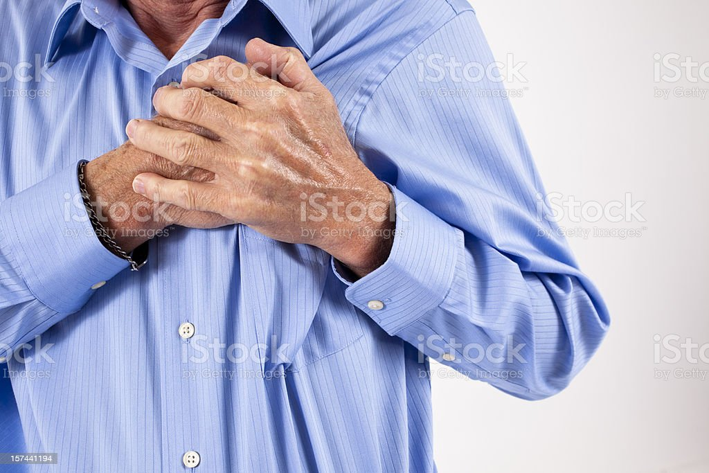 Man clutching his chest. in pain, possible heart attack royalty-free stock photo