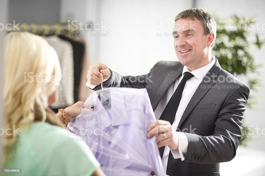 man collects dry cleaning stock photo