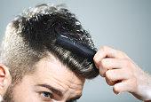 Man combing his hair.