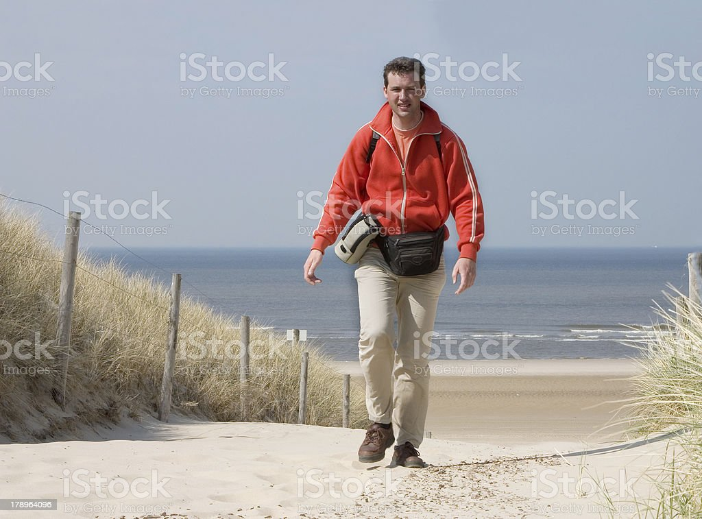 Man coming from the beach stock photo