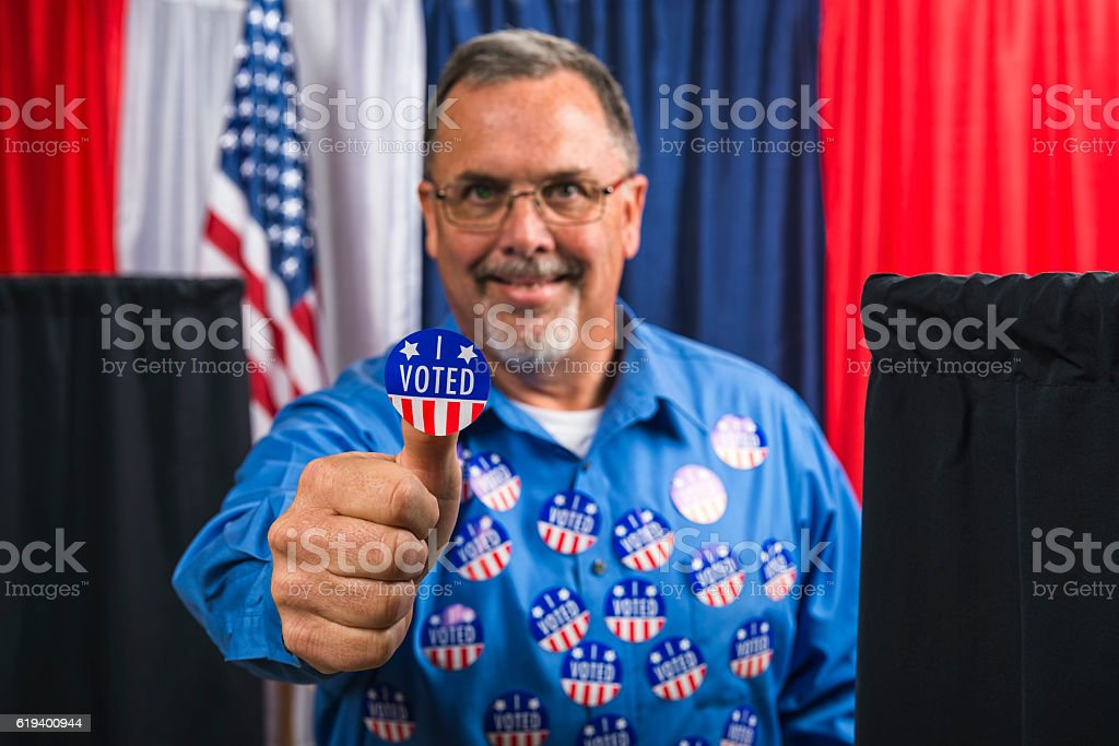 Man committing voter fraud by casting more than one vote stock photo