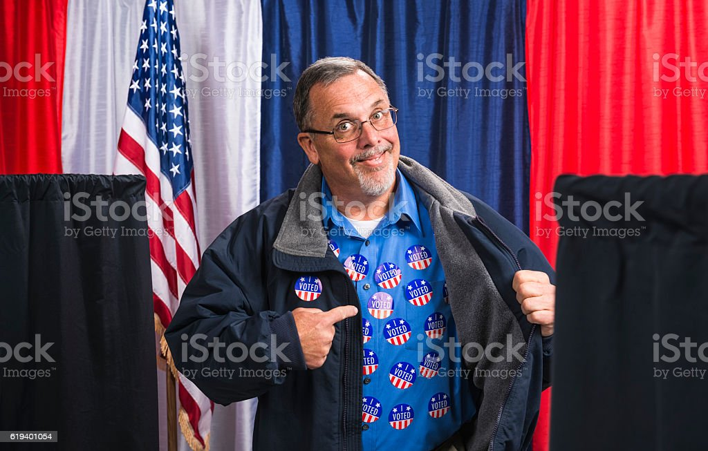 Man committing voter fraud exposes his many 'I VOTED' stickers stock photo