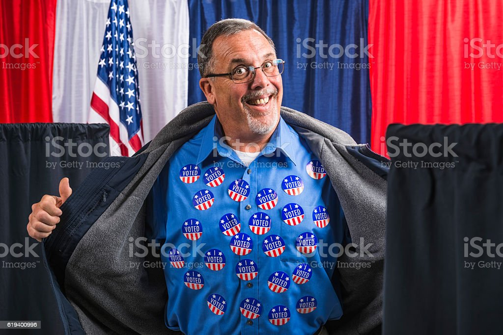 Man committing voter fraud exposing his many 'I VOTED' stickers stock photo