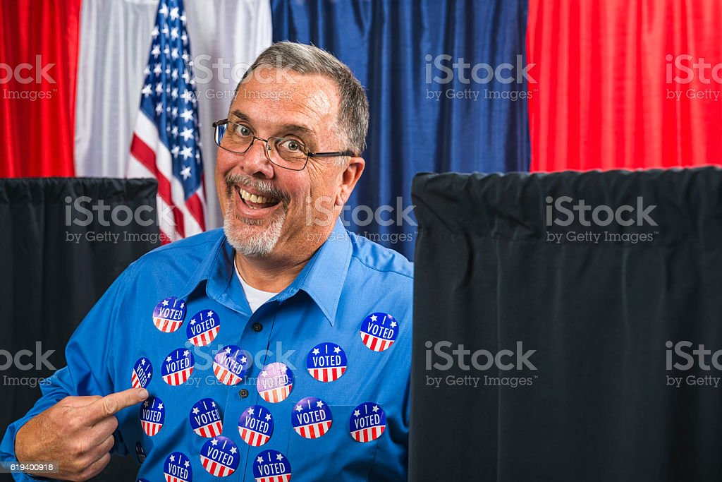 Man committing voter fraud shows off many 'I VOTED' stickers stock photo