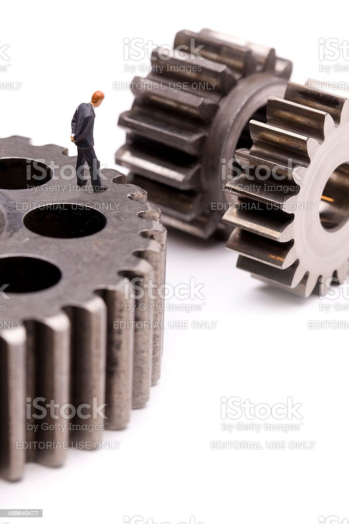 Man Compairing Gears stock photo