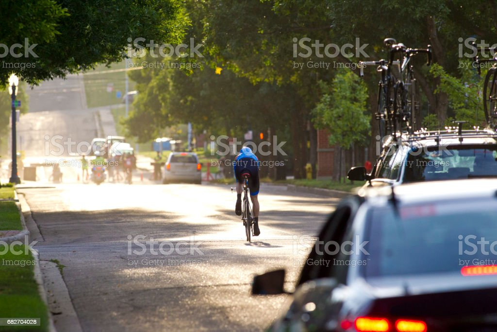 A man competes in a time trial during a professional road bike race. stock photo