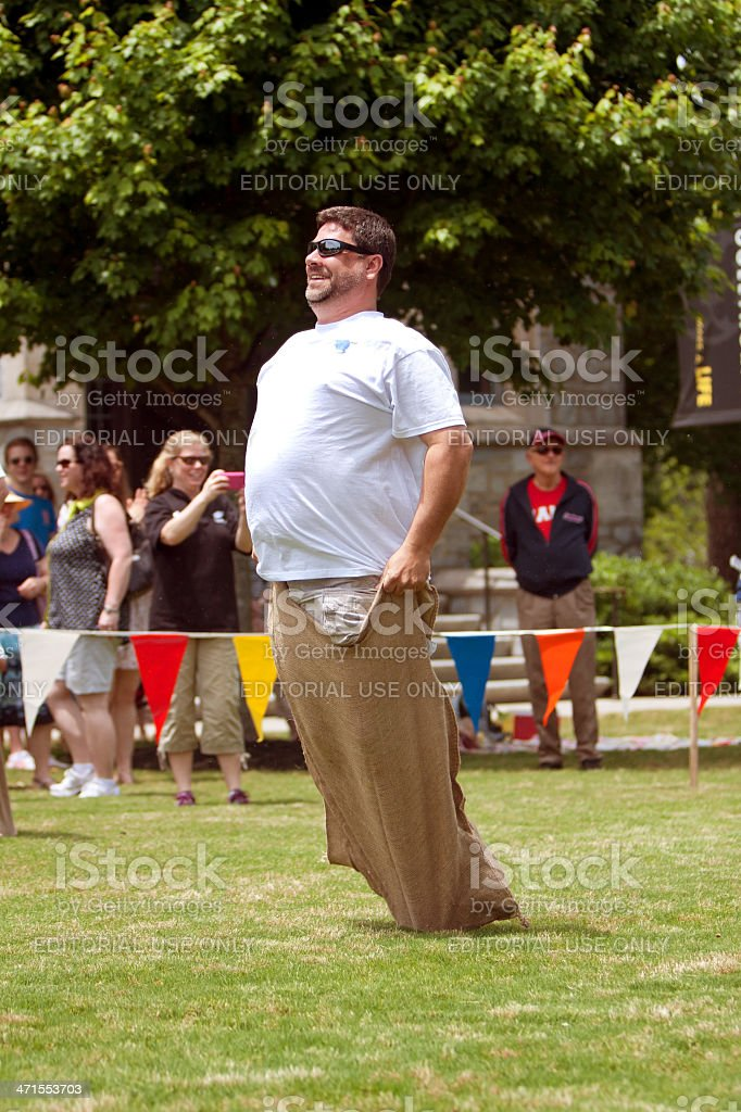 Man Competes In Sack Race At Spring Festival stock photo