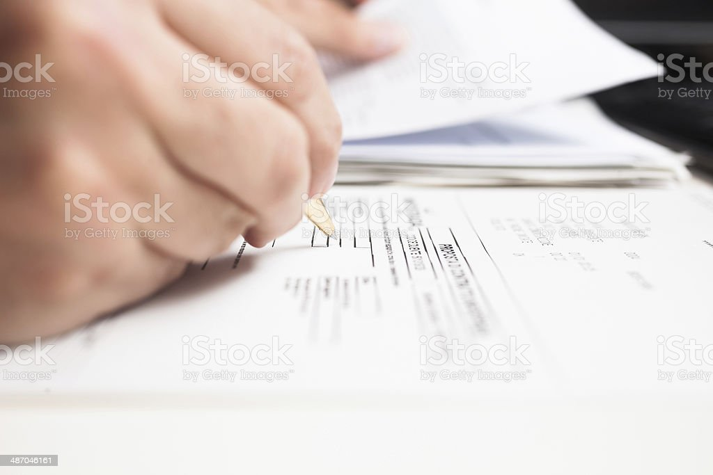 Man compiling a form stock photo