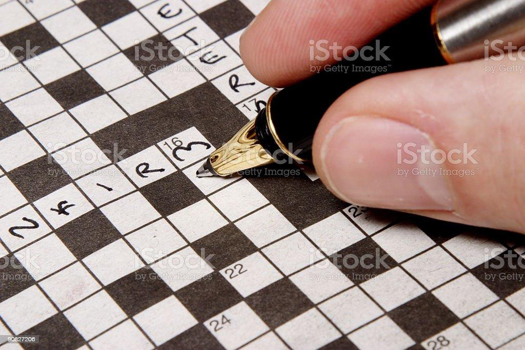 Man completing crossword stock photo